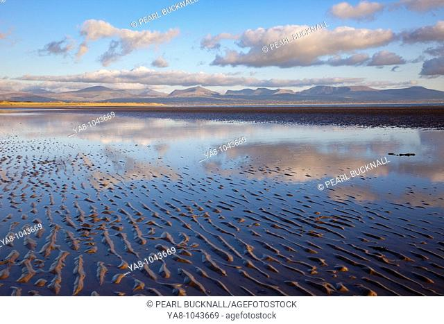 Newborough, Anglesey, North Wales, UK, Europe  Tidal pool reflecting clouds on Traeth Llanddwyn conservation beach in National Nature Reserve in early evening