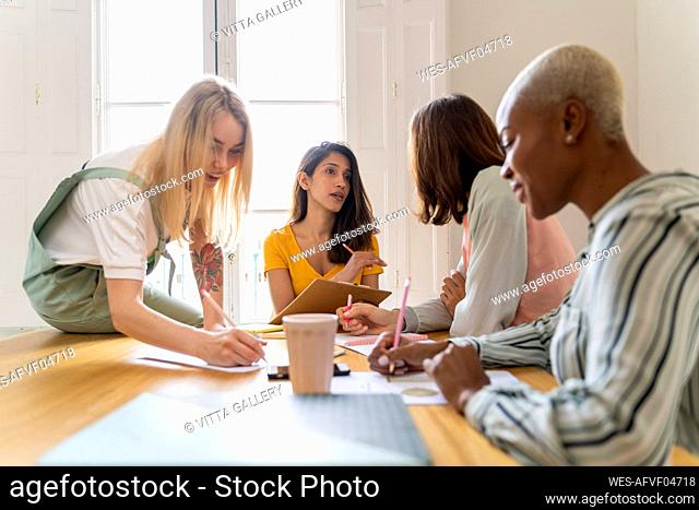 Businesswomen having a meeting and taking notes in office
