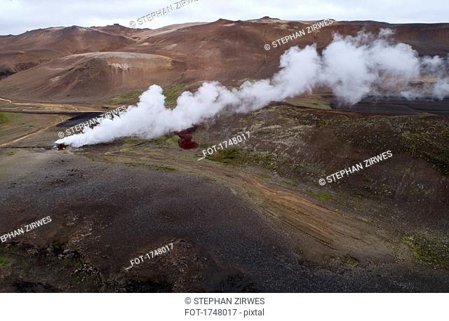 Drone view of smoke from containers on landscape, Mývatn, Iceland