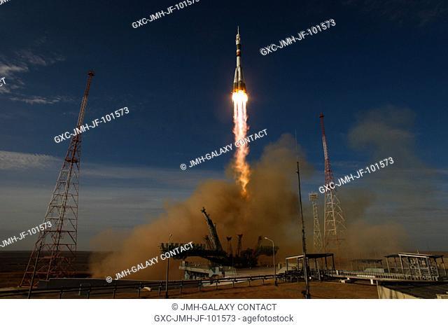 The Soyuz rocket with Expedition 3334 crew members, Soyuz Commander Oleg Novitskiy, Flight Engineer Kevin Ford of NASA, and Flight Engineer Evgeny Tarelkin of...
