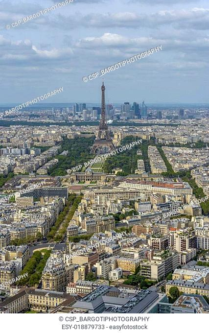 Aerial view of Eiffel Tower and La Defense business district tak