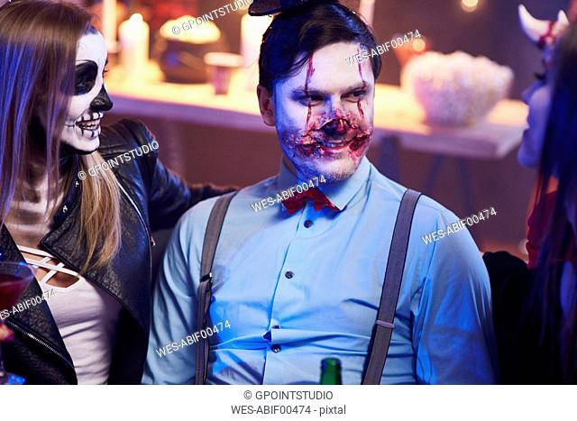 Best friends sitting at Halloween party