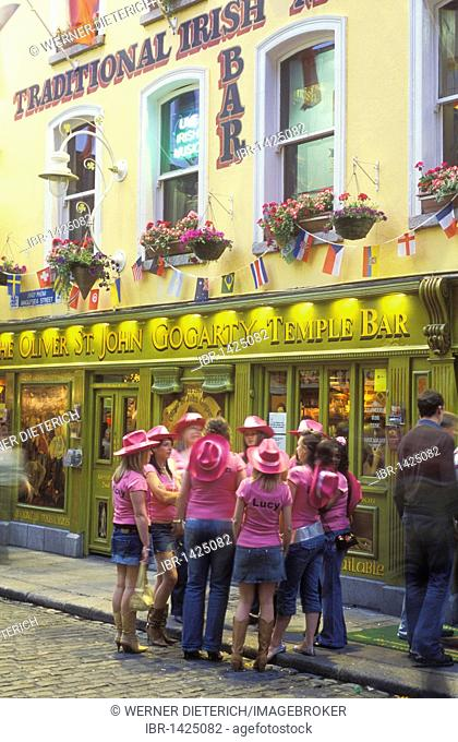 Young women on hen night, dressed up, in front of a pub, Temple Bar, Dublin, Ireland, Europe