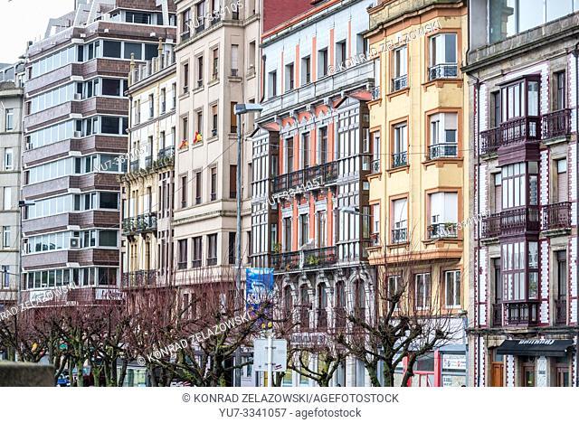 Residential buildings over Biscay Bay shore in Gijon in Asturias region, Spain