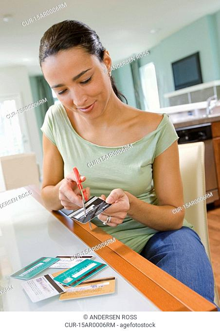Woman cutting credit cards