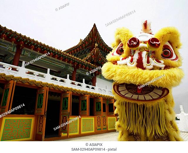 Chinese lion dance in front of temple