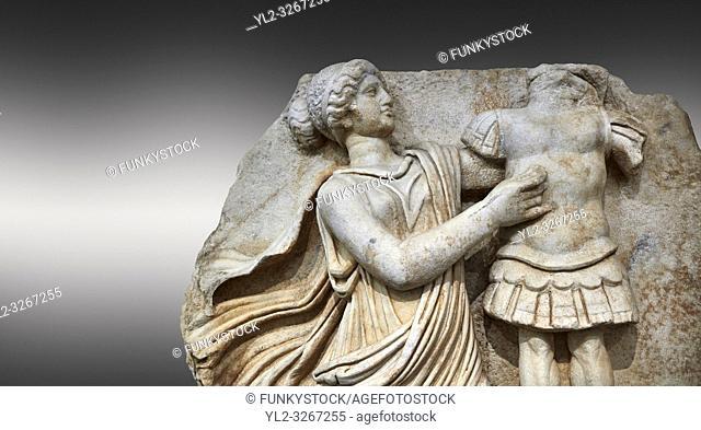 Close up of a Roman Sebasteion relief sculpture of a Goddess inscribing a trophy, Aphrodisias Museum, Aphrodisias, Turkey.
