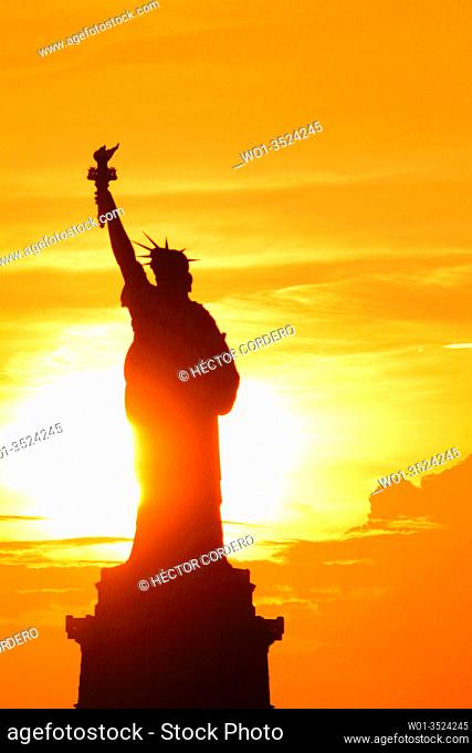 Liberty Statue during sunset in New York City