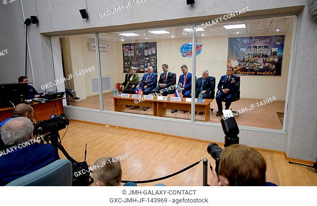 Expedition 50 prime and backup crews are seen in quarantine behind glass during the State Commission meeting to approve the Soyuz launch to the International...