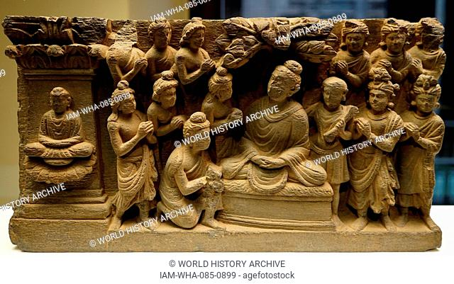 Gandhara Buddha accompanied by devotees; Pakistan; relief carved figures; Hellenic; 2nd-3rd century AD, made from schist stone