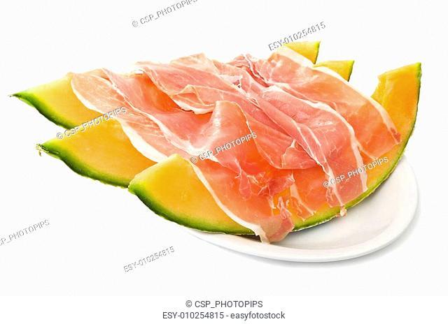 Ham and cantaloupe melon on the white