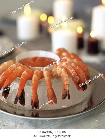 Ice-cooled shrimps with cocktail sauce by candlelight
