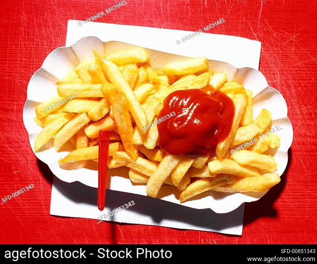 Chips with ketchup in a cardboard tray