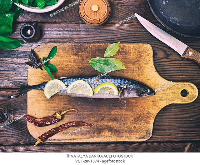 fresh mackerel on a wooden kitchen board, top view