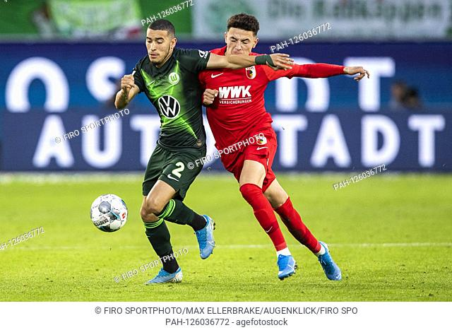 firo: 27.10.2019, Fuvuball, 1.Bundesliga, season 2019/2020, VfL Wolfsburg - FC Augsburg William (VfL Wolfsburg) in duels with Marco Richter (FC Augsburg) |...