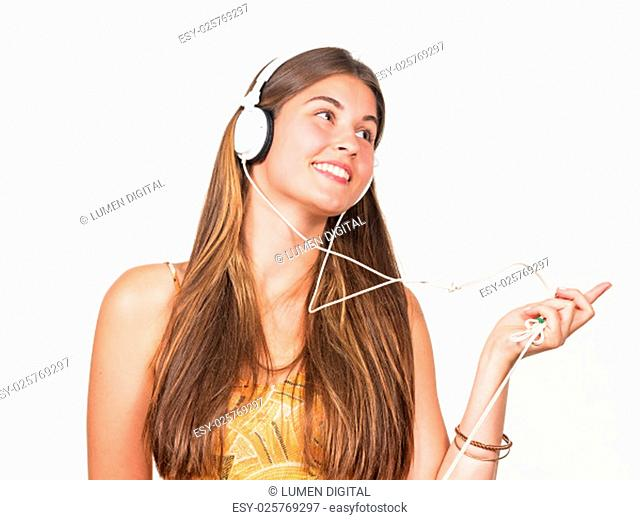 attractive young woman dancing with headphones