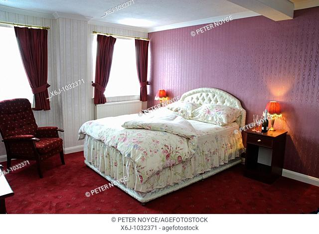 Hotel bedroom with double bed