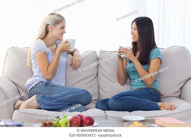 Friends chatting and drinking coffee
