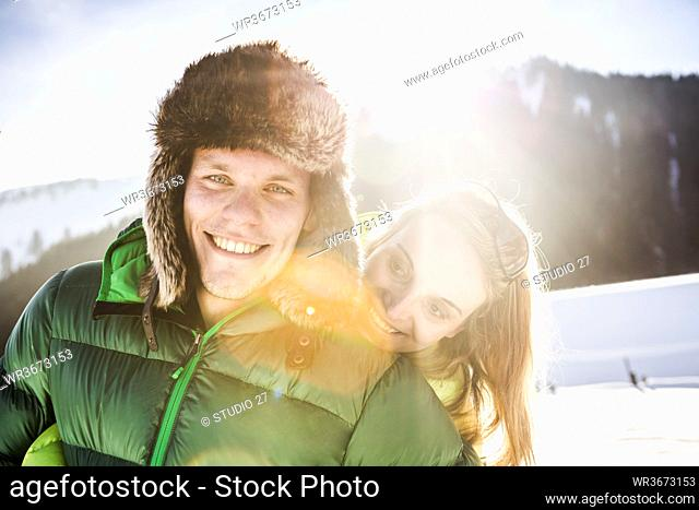 Portrait of happy couple in winter landscape, Achenkirch, Austria