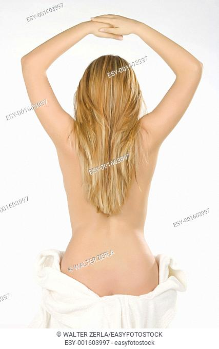 beautiful blonde woman in robe with long hair