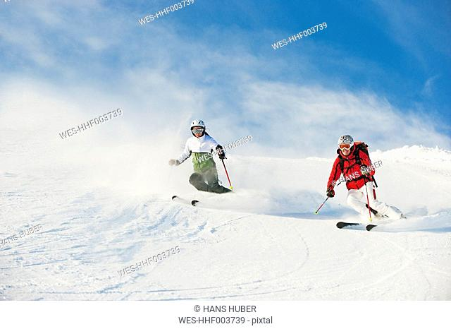 Austria, Salzburg Country, Altenmarkt-Zauchensee, Mid adult couple skiing on ski slope in winter
