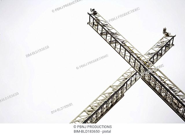 Low angle view of crane ladders
