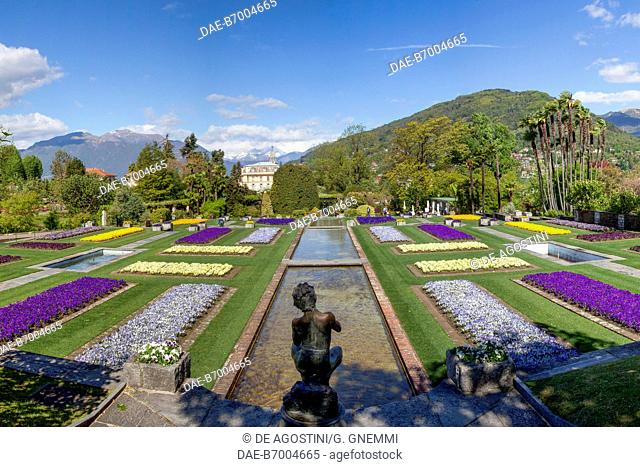Fountain and flower beds in the Botanical Gardens of Villa Taranto, Verbania, Lake Maggiore, Piedmont, Italy