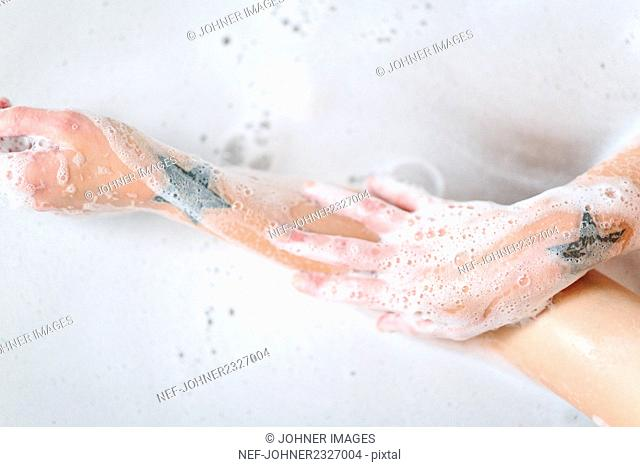 Hands covered by foam