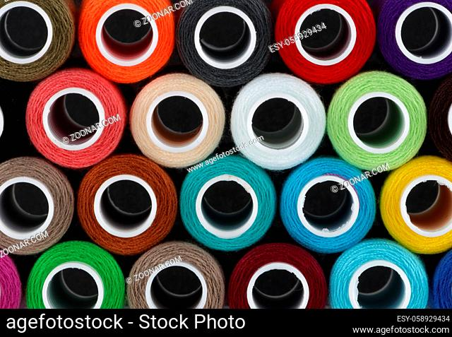 A colored cotton reels background pattern close up