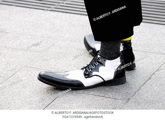Street performers, Clowns Without Borders in the Puerta del Sol de Madrid. Details of clown shoes