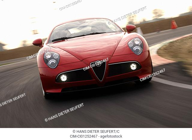 Alfa Romeo 8C, model year 2007-, red, driving, diagonal from the front, frontal view, test track