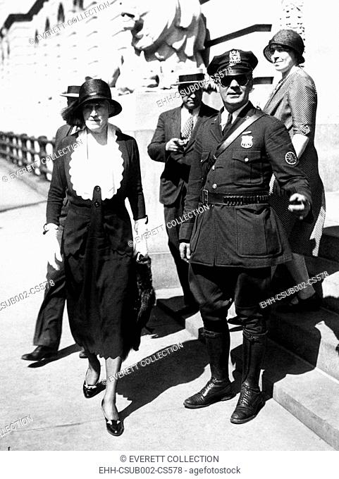 Mrs. Evelyn Menken, New York Socialite, leaving police headquarters. June 16, 1931. Three thieves broke into her home, bound and gagged her and stole $200