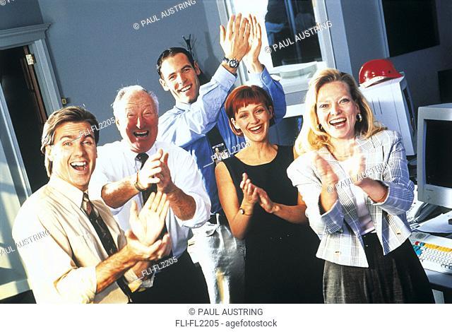 Executives applauding