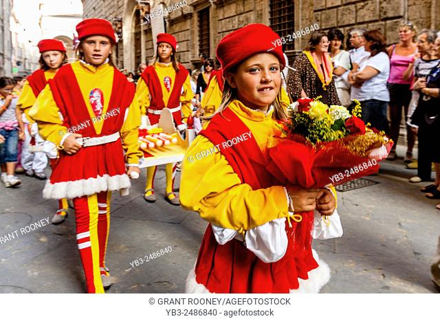 The Procession Of The Cero Votivo (Young People In Medieval Costume From Each Contrada Take Candles To The Duomo), The Palio di Siena, Tuscany, Italy
