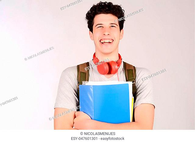 Portrait of young student holding notebook. Isolated white background