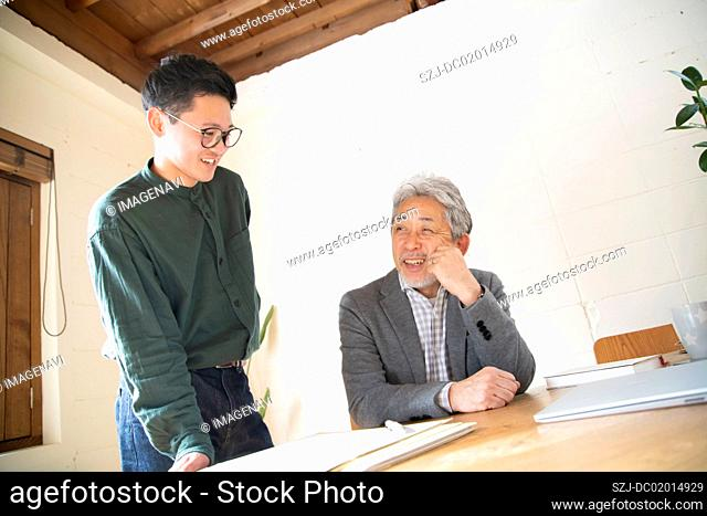 Young man discussing with boss