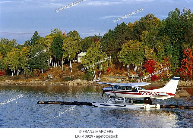 Floatplane on the Ambaisiers Lake in front of autumnal trees, Maine, USA, America