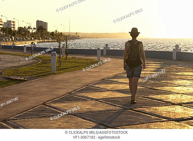A tourist walk on Campeche promenade at sunset, San Francisco de Campeche, state of Campeche, Mexico