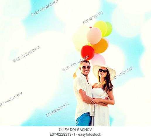 love, wedding, summer, dating and people concept - smiling couple wearing sunglasses with balloons hugging over blue lights background