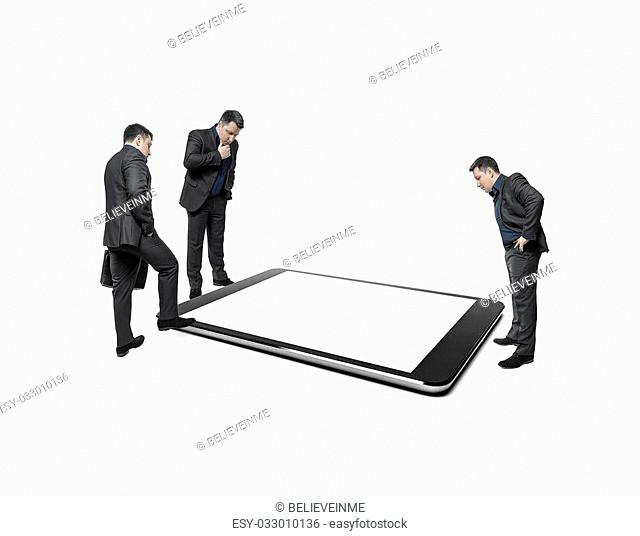 Businessmen take counsel, looking at huge display of tablet computer. On a white background. Conceptual image