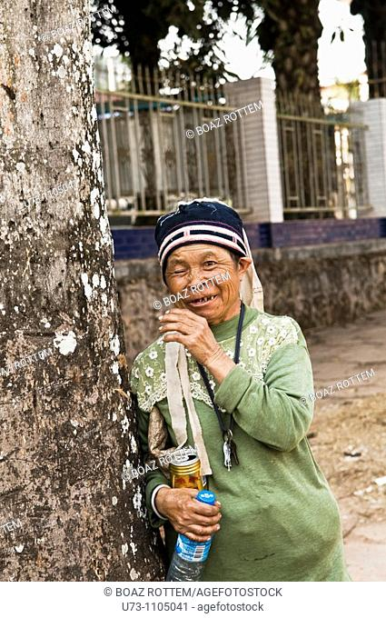 A smiling old blind woman in Yunnan, China