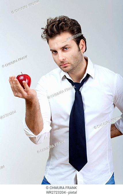 adult, apple, attractive, background, Caucasian, concept, diet, face, food, fresh, fruit, gray, hand, handsome, health, holding, isolated, looking, male, man