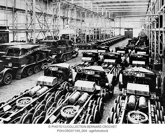 Manufacturing halftrack artillery tractors in a factory of the Krauss-Maffei German industrial group (Germany), during World War II