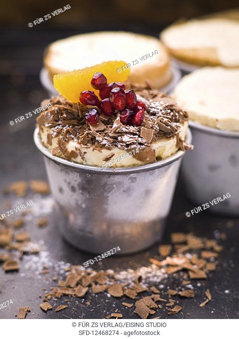 Small frozen desserts with fruit and grated chocolate