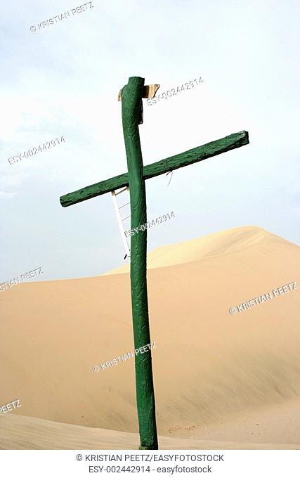 Lonely cross standing in the middle of the desert in Peru  Nothing else around    just this cross in the middle of nowhere