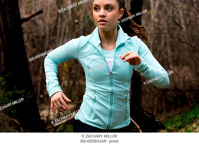 Young woman exercising, running, outdoors