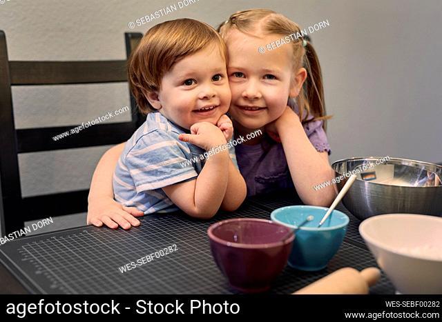 Portrait of happy siblings head to head