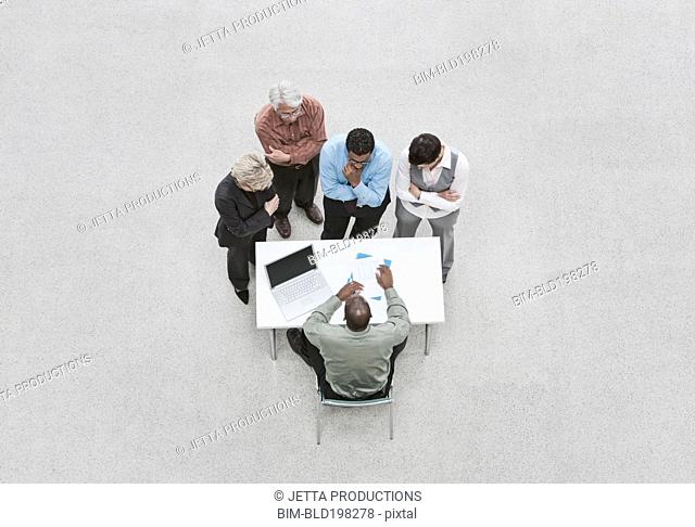 Business people in meeting with boss