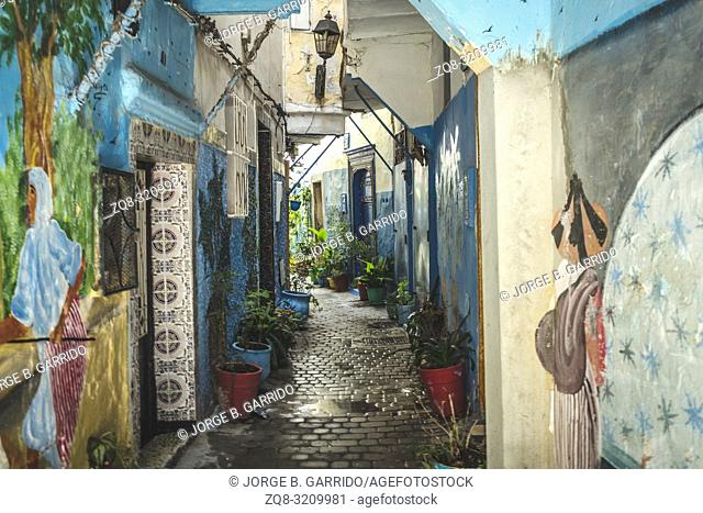 Ancient blue painted alley with old door entrance in the medina of Tanger (Tangier), northern Morocco