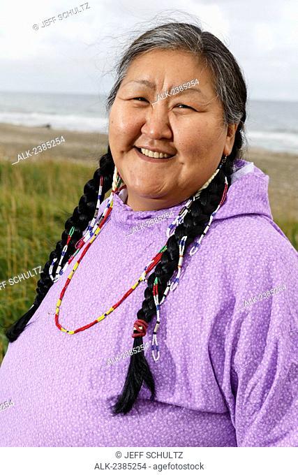Portrait of Yupik Eskimo woman in kuspuk standing outdoors Nome, Alaska, Summer